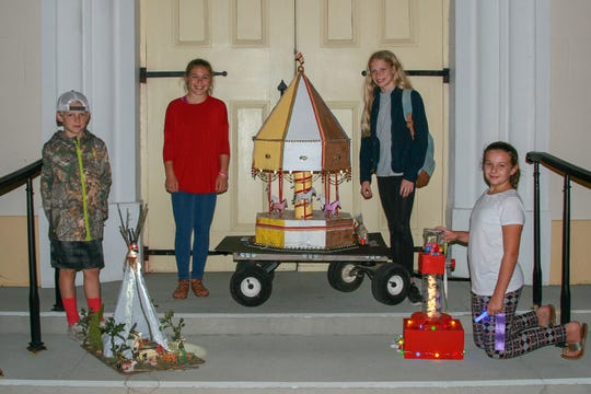 Kids make chariots out of cardboard that they've saved all year and show it off the first week of November. Sawyer Grace Francois, far right, shows off her chariot and winners ribbon in 2017.