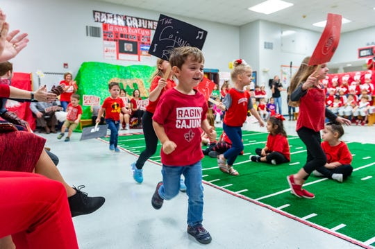 Students  at Fisher Early Childhood Development celebrate UL Homecoming week participating in Paint the Town Red activities. Wednesday, Oct. 30, 2019.
