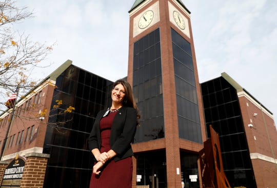 Donna Stalter stands in front of the government service center which houses the Fairfield County Job and Family Services office. Stalter is the public information specialist for the agency.