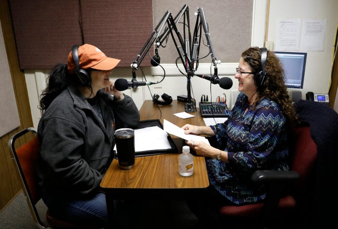 Fran Tiburzio, right, sits down with Michelle Stores to record the final episode of Tiburzio's community accent show Wednesday morning, Oct. 30, 2019, at the WFCO-FM studio in Lancaster. The radio station was sold to a group in and will begin simulcasting The River this week.