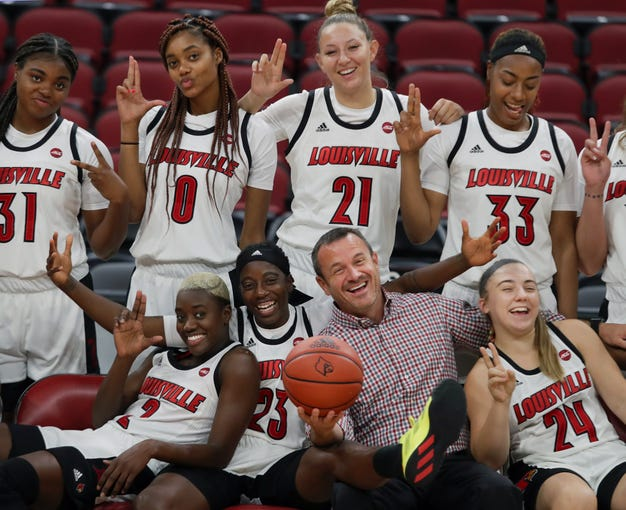The Louisville's Cardinals have a little fun as they get their team photo made during Louisville's Media Day on Oct. 30, 2019