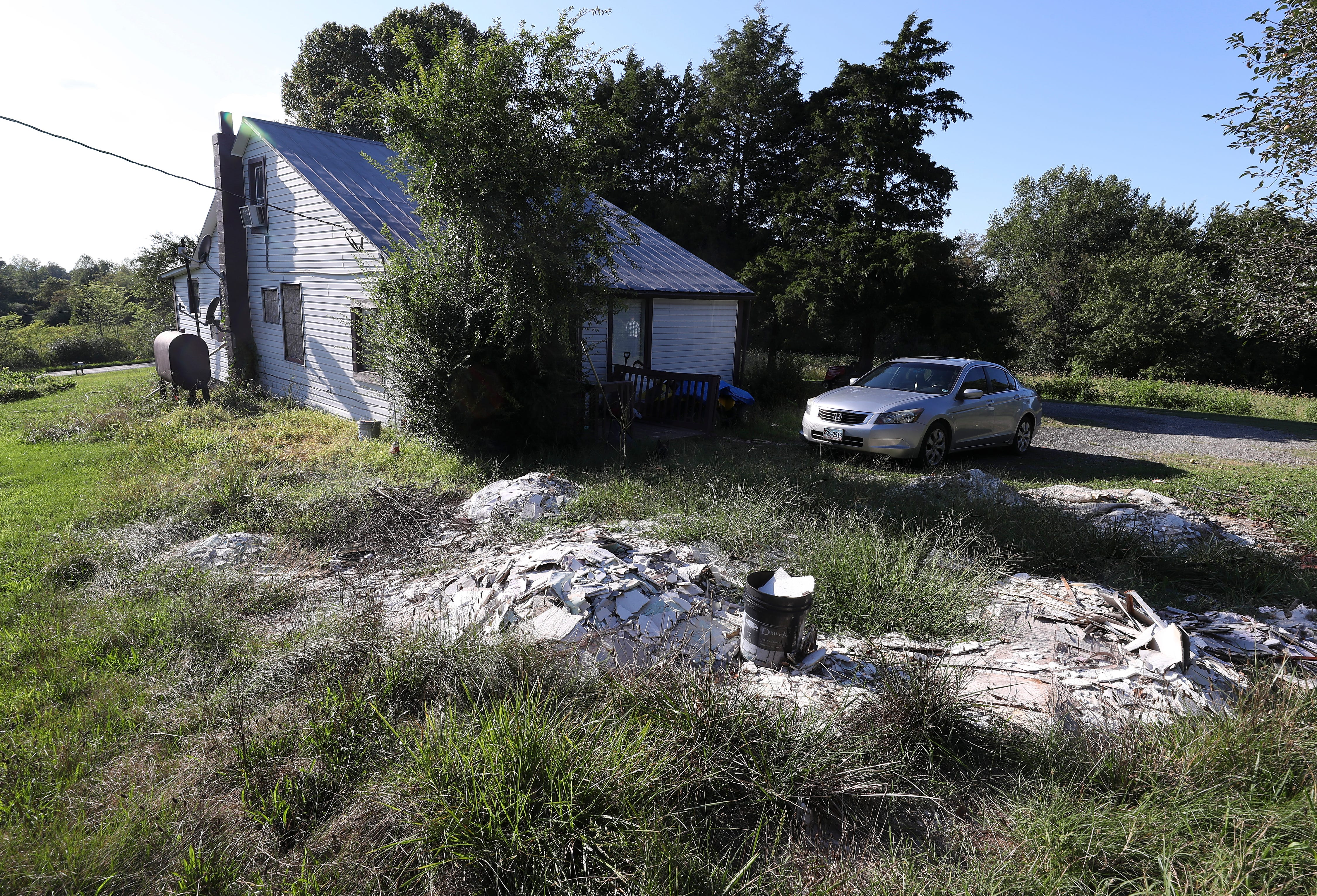 Part of a property in Axton, Virginia, that was identified in court papers as being related to an investigation of a cartel drug case. The remnants of damaged drywall is piled up in the backyard after new residents moved in.