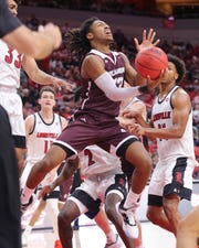 Bellarmine's Dylan Penn (13) shoots against the Louisville defense during their game at the Yum Center in Louisville, Ky. on Oct. 29, 2019.