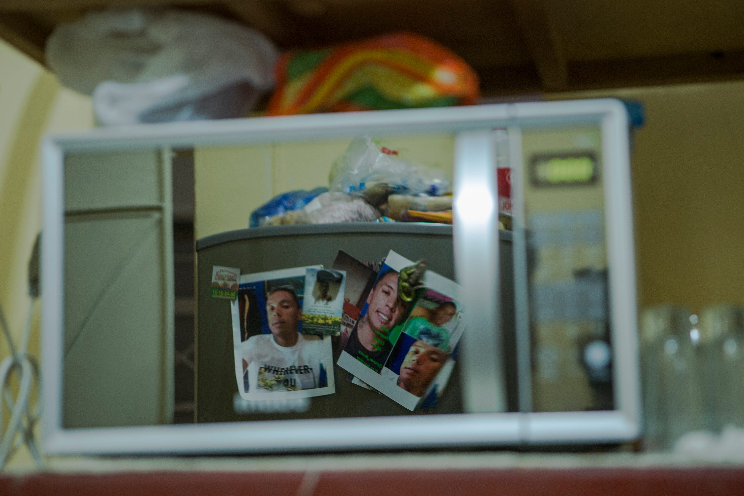 Photographs of Jorge Abraham Chávez Morán, who disappeared on July 19, 2017, in Zapopan, Jalisco, are reflected in his mother's microwave.