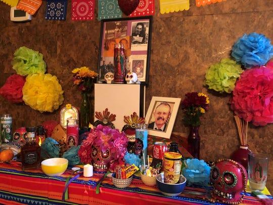 The Esparza family ofrenda includes photos of Alejandra and Fernando's grandparents.