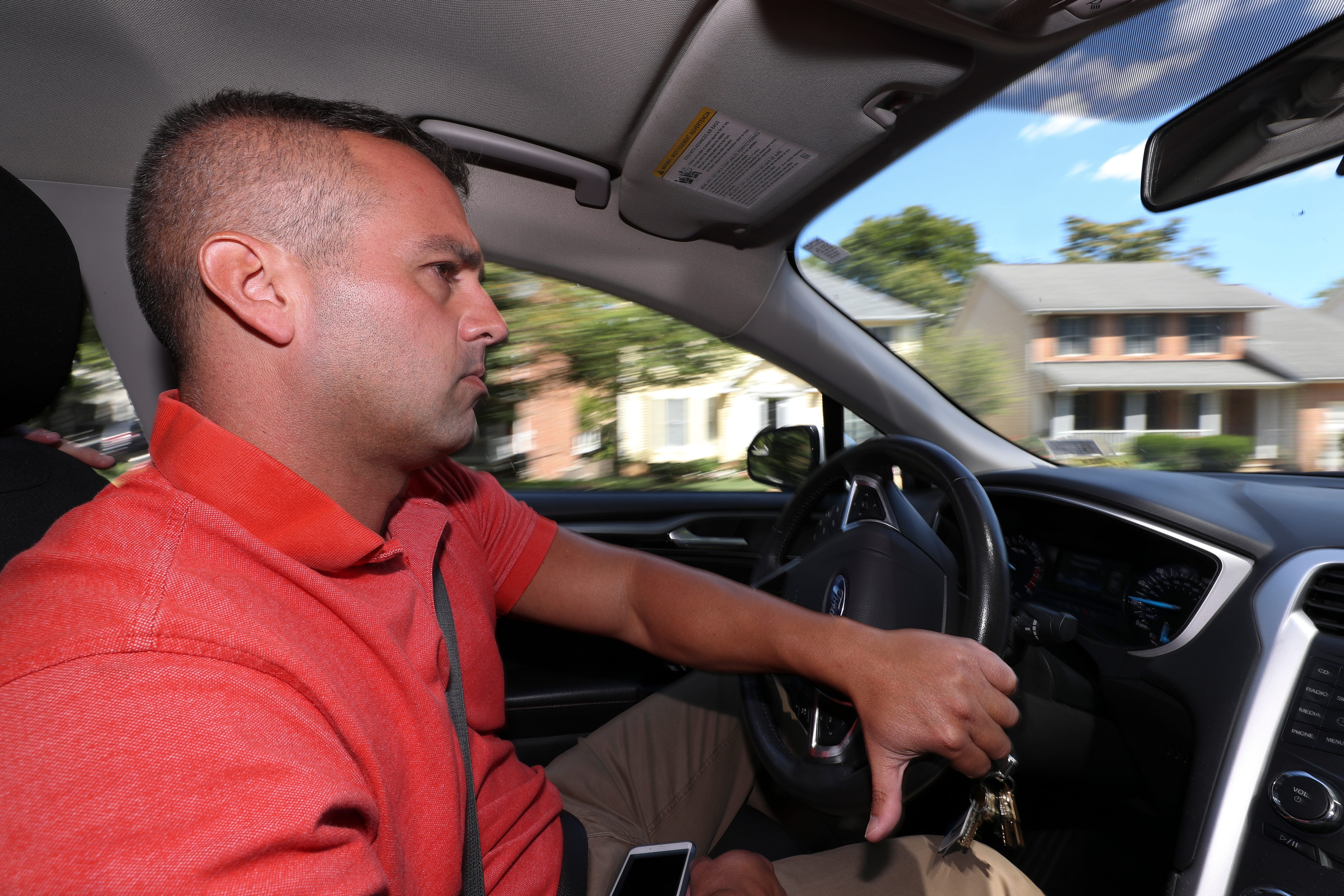 Josiah Schiavone, a member of the Virginia State Police, drives through downtown Winchester, Virginia. Prosecutors in 2018 said drugs were trafficked by associates connected to Mexico's Cartel Jalisco Nueva Generación, or CJNG.