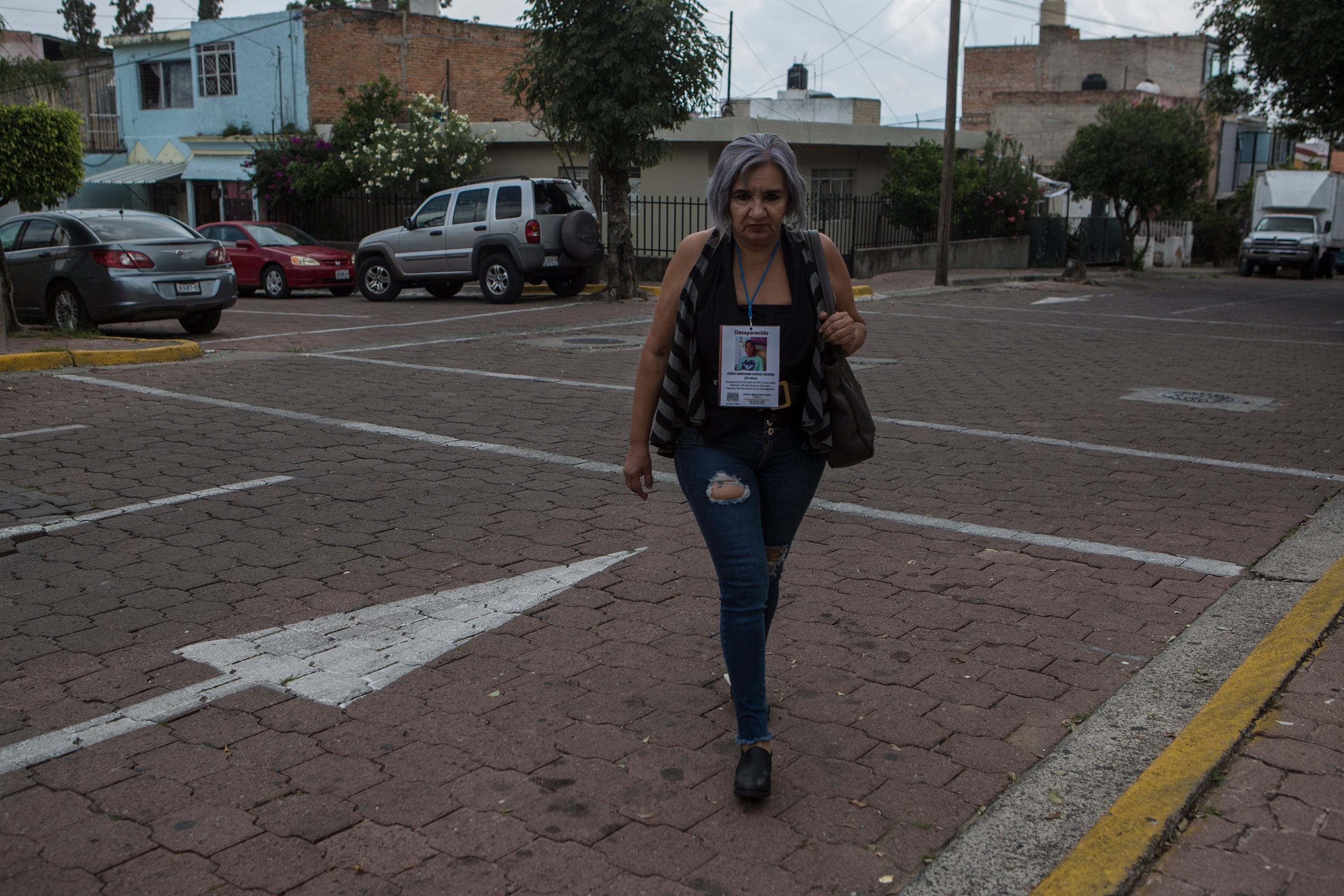 Silvia Morán walks on Libertad Street where her son Jorge Abraham Chávez Morán was taken by an armed command on July 19, 2017, in the city of Zapopan, Jalisco. More than two years after his disappearance, Silvia still has no information about his whereabouts.