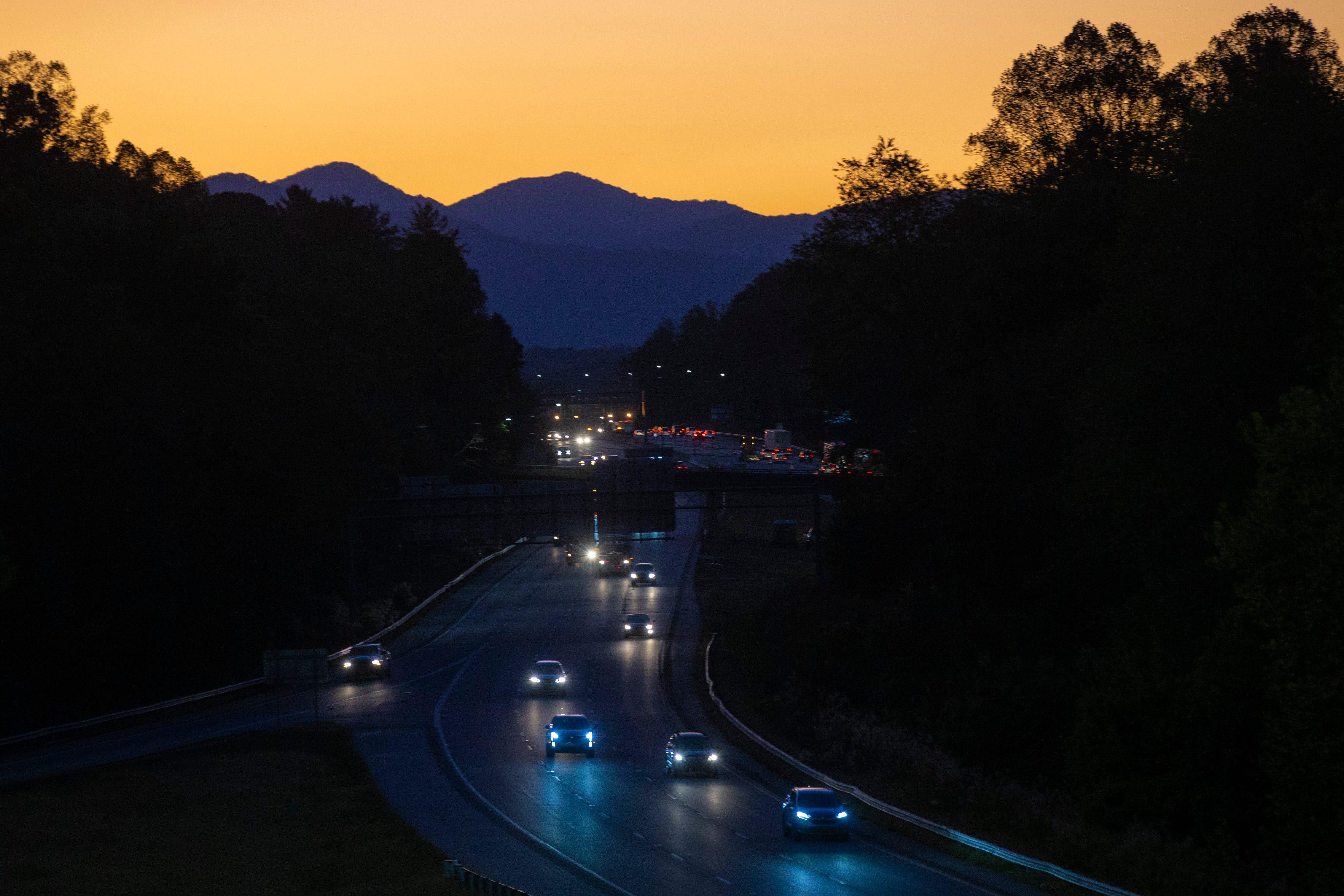 Motorists travel along US-74 in North Carolina at dusk. Oct. 3, 2019