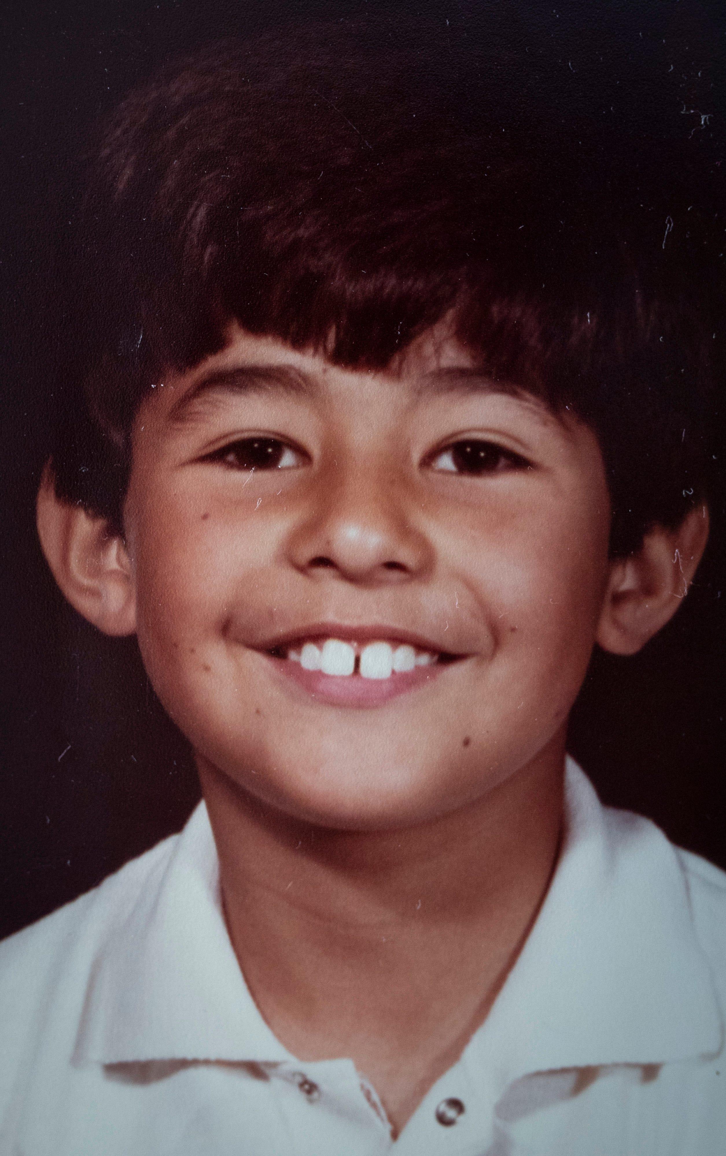 A family photograph of Oscar Macias at age 6.