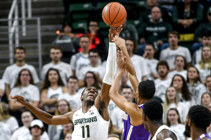 Michigan State's Aaron Henry, left, blocks a shot by Albion's MJ Barnes during the first half on Tuesday, Oct. 29, 2019, at the Breslin Center in East Lansing.