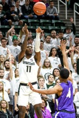 Michigan State's Aaron Henry, left, scores as Albion's MJ Barnes defends during the first half on Tuesday, Oct. 29, 2019, at the Breslin Center in East Lansing.