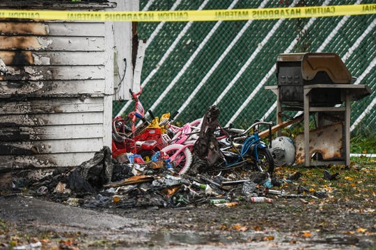 Toys and bikes in the aftermath of a fire at a home in the 2000 block of New York Avenue near Lake Lansing Road seen Oct. 30, 2019. Three children died and four other people were injured, according to fire officials.
