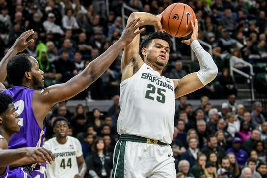 Michigan State's Malik Hall, right, rebounds as Albion's Quinton Armstrong closes in during the first half on Tuesday, Oct. 29, 2019, at the Breslin Center in East Lansing.
