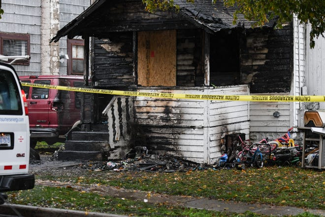The aftermath of a fire at a home in the 2000 block of New York Street near Lake Lansing Road on Oct. 30, 2019,  Three children died and four other people were injured, according to fire officials.