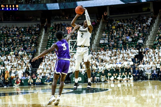 Michigan State's Rocket Watts, right, as Albion's Cortez Garland during the first half on Tuesday, Oct. 29, 2019, at the Breslin Center in East Lansing.