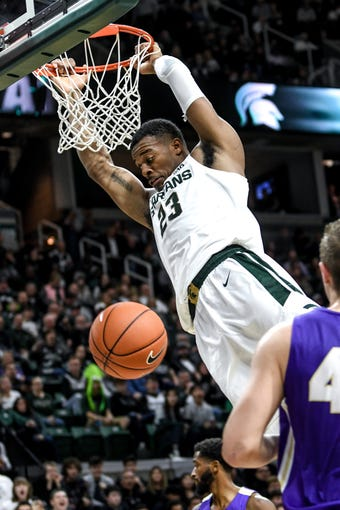 Michigan State's Xavier Tillman dunks off a pass from Cassius Winston during the first half on Tuesday, Oct. 29, 2019, at the Breslin Center in East Lansing.
