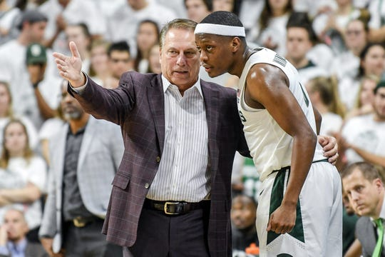 Michigan State's head coach Tom Izzo, left, talks with Cassius Winston during the second half on Tuesday, Oct. 29, 2019, at the Breslin Center in East Lansing.