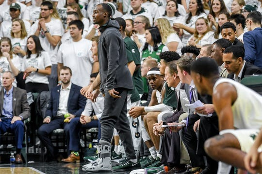 Michigan State's Joshua Langford cheers on the team from the sideline during the first half on Tuesday, Oct. 29, 2019, at the Breslin Center in East Lansing.