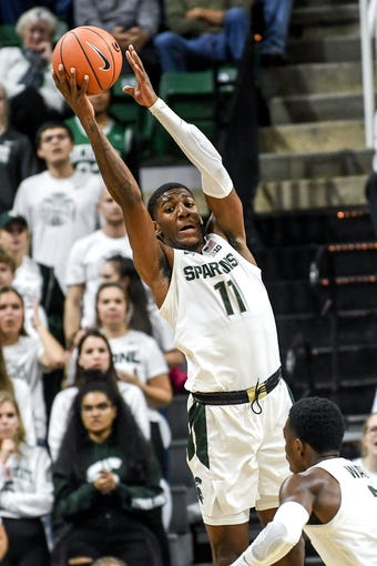 Michigan State's Aaron Henry grabs a rebound during the first half on Tuesday, Oct. 29, 2019, at the Breslin Center in East Lansing.