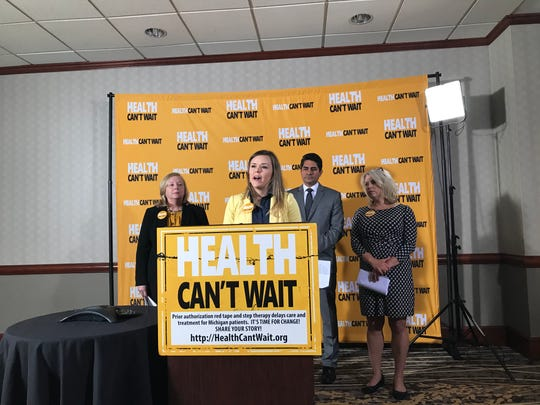 Lyndsey Crosbie, of Dearborn, talks at a press conference where medical and patient advocates rallied behind legislation to limit delays in care by insurance companies.