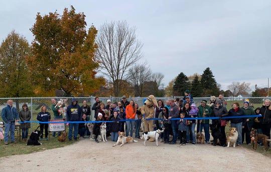 Manitowoc Mayor Justin Nickels cuts the ribbon on the new Halvorsen Park Dog Park on Oct. 26.