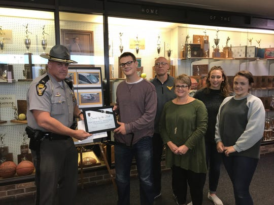 """Bucyrus patrol Lt. Scott Rike presented a """"Saved by the Belt"""" award to Nic Teglovic Tuesday. With them are his parents Ryan and Lori and his sisters Allison and Molly."""