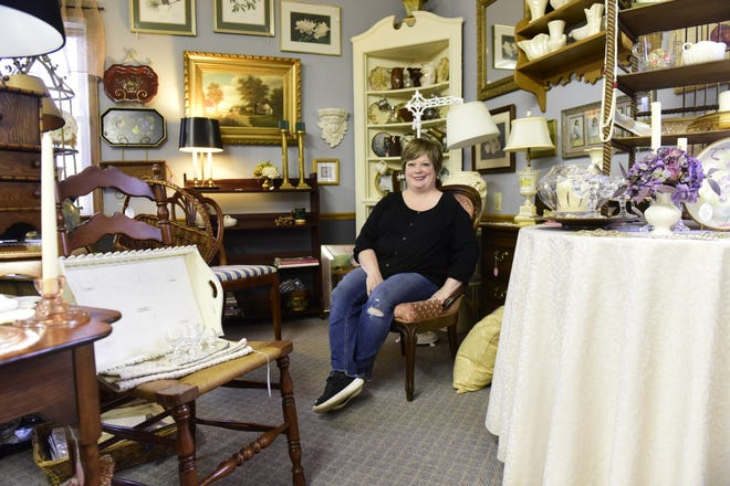 Heather Evans sits inside her shop, Petit Tresor Boutique, not far from where she grew up along South Main Street in Mansfield.