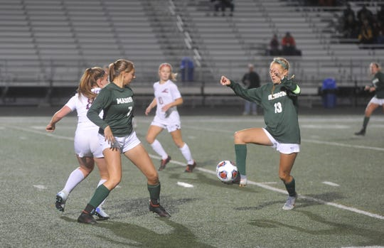 Taylor Huff controls a pass from Kari Eckenwiler for the Madison Rams, who reached the state soccer finals for the first time