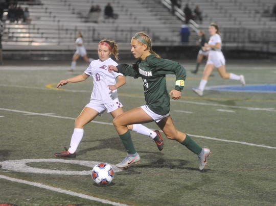 Madison's Taylor Huff dribbles past Rocky River's Cara McKenna.