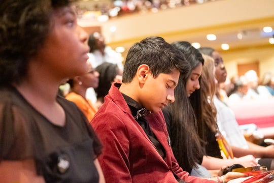 Krishnav Manga inspects his Keeper of the Dream Award during the Freedom Award student forum at Mississippi Boulevard Christian Church on Oct. 30, 2019.