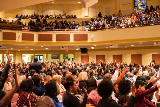 A large crowd cheers and applauds Hafsat Abiola, Gloria Steinem, and John Legend during the Freedom Award Student Forum at Mississippi Boulevard Christian Church, Wednesday morning, October 30.