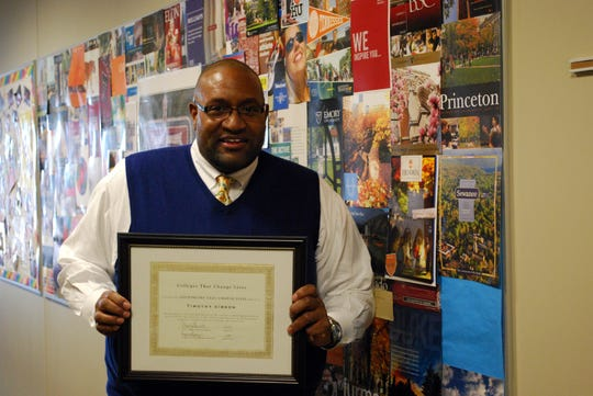 "In this file photo, Timothy Gibson of St. George's Independent School poses with a certificate from the Colleges that Change Lives Consortium recognizing him as a ""Counselor that Changes Lives."" In 2013, he was one of six college counselors in the nation to receive the designation. St. George's announced on Oct. 27, 2019, that Gibson has been selected as interim head of school."