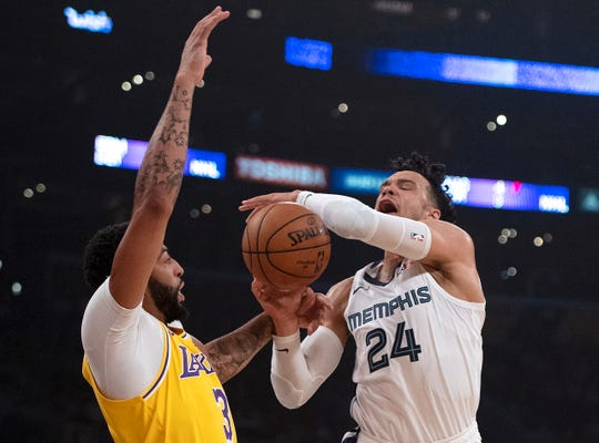 Memphis Grizzlies guard Dillon Brooks, right, draws a foul from Los Angeles Lakers forward Anthony Davis during the first half of an NBA basketball game in Los Angeles, Tuesday, Oct. 29, 2019.