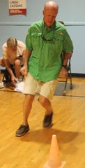 "Rotarian Alan Sandlin does the ""50-foot dash"" as part of the participants' fitness assessment."