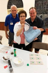 On Oct. 24, the Knights of Columbus San Marco Council #6344 hosted a Bingo Night in the San Marco Parish Center. The Coach bag winner Joanne Gizzi of New Jersey.