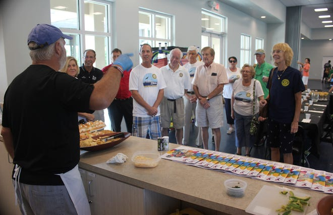 Chef Michael Passero serves up some of his healthy creations during the visit to the Y by members of the Marco Island Rotary Club Noontime.
