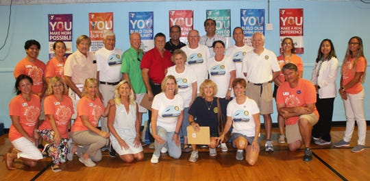 The Rotarians pose with Y staffers (dressed in the colorful t-shirts).