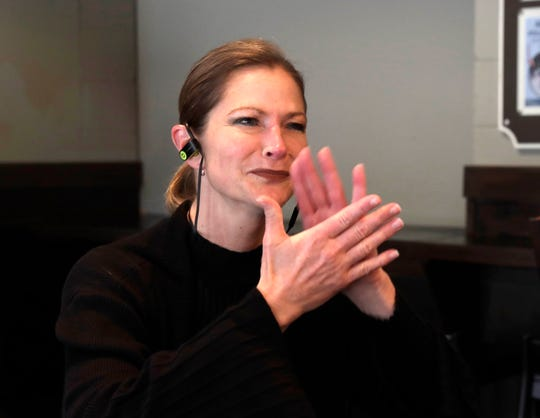 """American Sign Language (ASL) interpreter Pamela Sue Conine listens to an audio recording of """"Hamilton"""" to rehearse before a recent Saturday matinee of """"Hamilton"""" at the Marcus Center for the Performing Arts."""