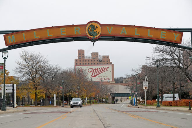 A Miller Valley sign spans West State Street in Milwaukee.