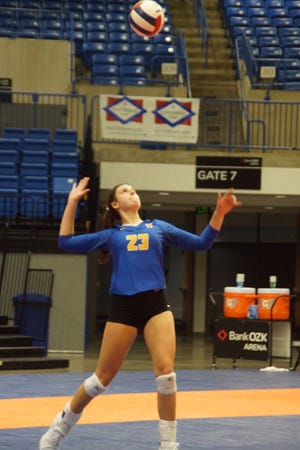Mountain Home's Claudia Carter serves during the Lady Bombers' three-set sweep of Russellville on Tuesday at Hot Springs.