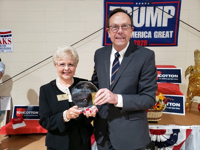Representative Nelda Speaks(left), of Mountain Home,accepts a 2019 Statesman Award from Jerry Cox, President of Family Council Action Committee based in Little Rock. The award is given based WIlburn's votes during the 92nd General Assembly on the 25 bills on the Family Council Action Committee's report card.