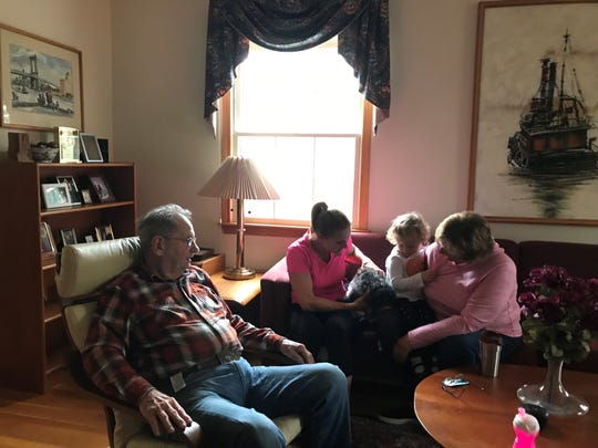 Dave Buchner, 90, sits alongside his daughters Annie Buchner Delargy, her dog Diesel, his grandaughter Jillian, and oldest daughter Cathy Buckner Malicki.