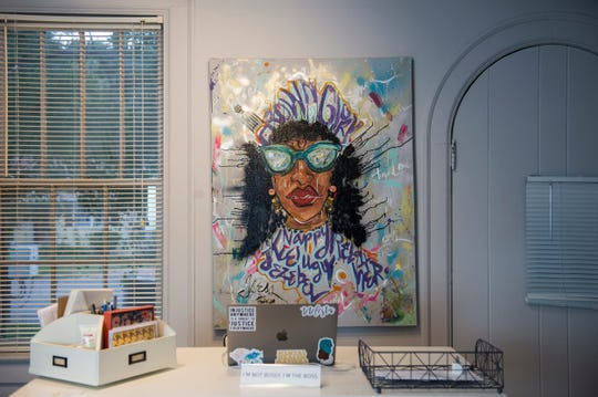 A Michelle Browder original hangs in Nicole King's shop at Tre'ss Bien Salon in Montgomery, Ala., on Wednesday, Oct. 30, 2019.