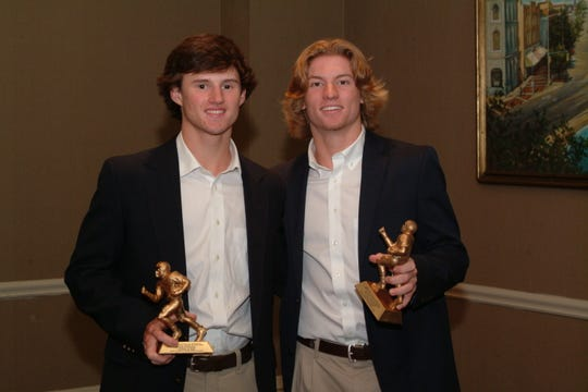 The Montgomery Quarterback Club honored (from left) Lowndes Academy's John Morgan and Pike Road's Easton Wilcoxson at its Oct. 29 meeting.