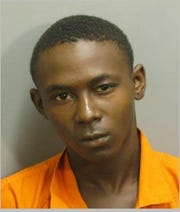 Nigel Tyrese Moore was charged with three counts of first-degree robbery.