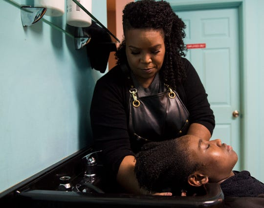 Owner Nicole King works on a customers hair at Tre'ss Bien Salon in Montgomery, Ala., on Wednesday, Oct. 30, 2019.