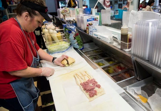 Kristy Jackson makes some sandwiches at at the Scott Street Deli in Montgomery, Ala., on Wednesday, Oct. 30, 2019.