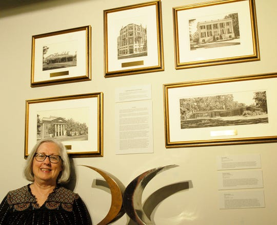 Montgomery artist Melissa B. Tubbs with five of her pen and ink drawings being presented by MABCA as awards on Nov. 7.