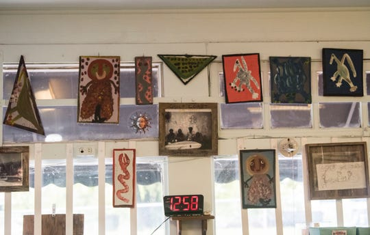 Mose T artwork hangs on the wall at the Scott Street Deli in Montgomery, Ala., on Wednesday, Oct. 30, 2019.
