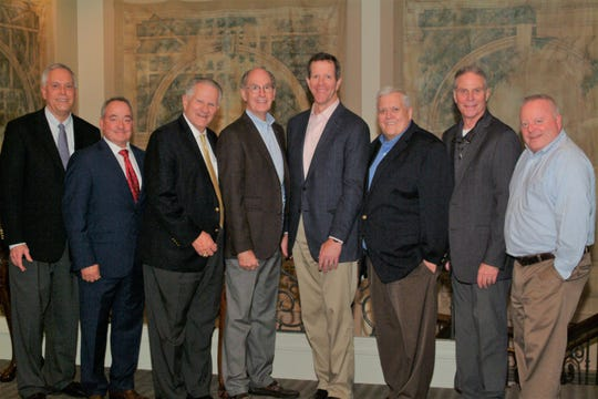 ESPN's Ivan Maisel was the featured speaker at the October 29 meeting of the Montgomery Quarterback Club. From left, he is joined by board member Sam Johnson, Jimmy Marston, CEO of Gulf Distributing Holdings, club member Jack Galassini, Maisel family friend Young Boozer, Maisel, board member Dr. David Bowen, All-State Beverage General Manager Marc Kirklin, and board member Alva Lambert.